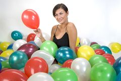 Smiled girl. In colorful baloons Royalty Free Stock Photos