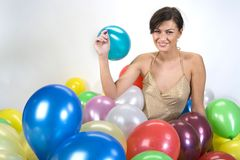 Smiled girl. In colorful baloons Royalty Free Stock Image