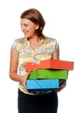Smiled girl holds three multi-coloured folders Stock Images