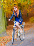 Smiled girl is riding the bike. Royalty Free Stock Images