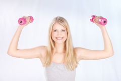 Smiled woman doing fitness exercises Stock Images