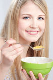 Smiled woman holding spoon and plate. Preparing to eat cornflex stock photography