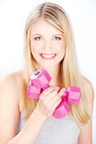Smiled woman holding two weights Stock Images