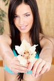Smiled woman holding white orchid Stock Photography