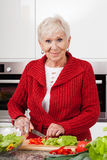 Smiled woman preparing meal Stock Image