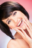 Smiled woman. Pretty smiled woman on red background Royalty Free Stock Photos