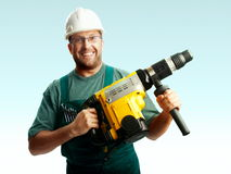 Smiled workman in helmet hold perforator. Smiled workman in helmet, glasses and overalls hold perforator in his hands over white background Stock Images