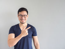 Smileing Asian man point on empty space. Royalty Free Stock Photo