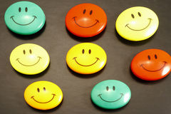 Smiles. A lot of smiles on the black background Royalty Free Stock Photos