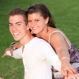 Smiles. Happy people, piggyback couple with perfect smiles Royalty Free Stock Image