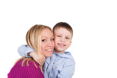 Smiles. Cute little boy embracing his beautiful mother Stock Images