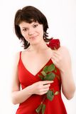Smiles. The Studio portrait of the beautiful girl with a rose royalty free stock photos