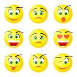 Smiles. Yellow smiles on the white background Stock Photography