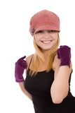 Smiles. Portrait of the beautiful young girl in gloves on a white background stock photo