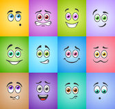 Smiles with colored eyes on colored background Royalty Free Stock Photo