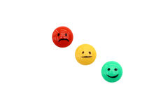 Smiles and emotions. Three emotions shown by three colored smiles stock image