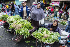 The Smiles of Greengrocer. The smile is one way merchants in Takengon to attract buyers to be willing to stop by and buy their merchandise stock photos