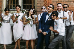 Smiles of the groom with bridesmaids and groomsmen Stock Photography