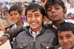 Smiles of group of boys. JAISALMER, INDIA: Kids have fun during the famous indian Desert Festival on March 2, 2015. Every winter Jaisalmer takes the Desert Royalty Free Stock Images