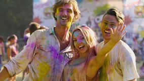 Smiles on happy faces of young people enjoying traditional indian holi festival. Stock footage stock video