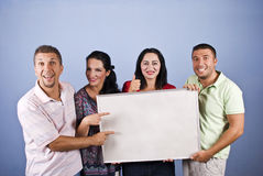 Smiles people against blank banner Stock Photography