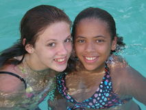 Smiles in the Pool. A picture of best friends in a swimming pool together Royalty Free Stock Photos