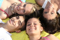 Smiles, white teeth. Smiles, white smiling teeth, group of happy teens royalty free stock photos