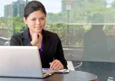 Smiles of young Asian businesswoman. Working outside Royalty Free Stock Photo