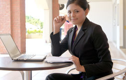 Smiles of young Asian businesswoman Royalty Free Stock Photography
