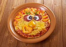 Smiley смотрел на пиццу Стоковая Фотография RF