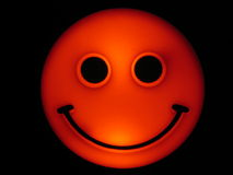 Smiley. Orange glowing smiley Stock Photo