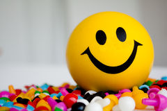 Smiley. On colour pins on the white background Royalty Free Stock Photo