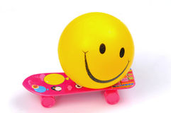 Smiley. On skates over white background Royalty Free Stock Images
