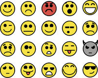 20 smiley amarelos engraçados Fotografia de Stock