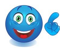 Smiley azul con una mano que señala el finger fotografía de archivo