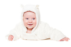 Smiley baby lying on white floor Stock Images