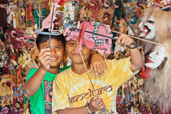 Smiley Balinese children play with shadow puppets Royalty Free Stock Images