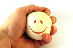 Smiley ball in hand. Smiley ball in hand, isolated on white royalty free stock photos