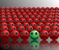 Smiley ball stands out in a crowd Stock Images