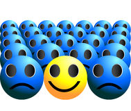 Smiley ball stands out in a crowd Royalty Free Stock Image