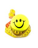 Smiley ball and tape measure Royalty Free Stock Images