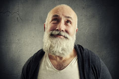 Smiley bearded man looking up Stock Photo