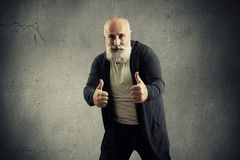 Smiley bearded man showing thumbs up Royalty Free Stock Photo