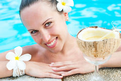 Smiley beautiful woman with coconut Royalty Free Stock Photography