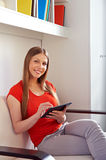 Woman working with tablet pc at home stock photography