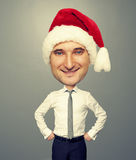 Smiley bighead man in santa hat Stock Image