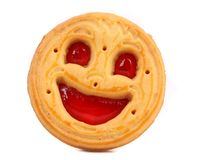 Smiley biscuit on a white background. Royalty Free Stock Images