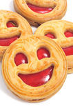Smiley biscuits. Closeup of some smiley biscuits on a white background Stock Images