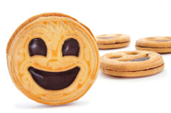 Smiley biscuits. Some smiley biscuits on a white background stock photo