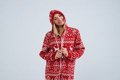 Smiley blond in christmas pajamas. Over white background Stock Photo